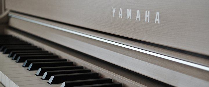 买雅马哈还是Kawai钢琴?